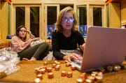 Alison Tant, right, watches for the results of the presidential election and eats chocolate with her daughter Danielle Richards, 17, after being declared the winner of the 2020 election for Florida House of Representatives District 9.