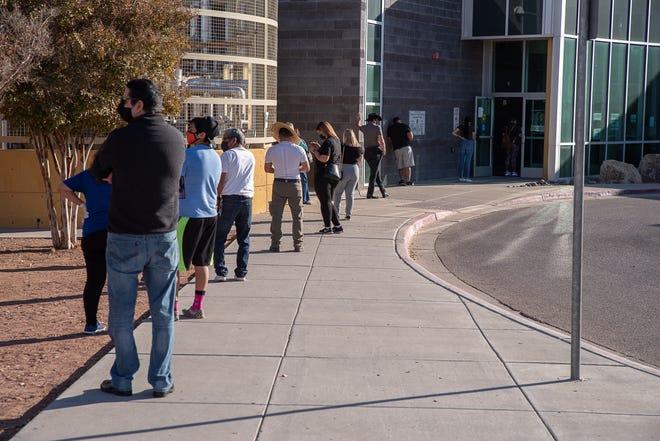 Dozens line up to vote outside the Esperanza Acosta Moreno Library in east El Paso on Nov. 3, 2020.