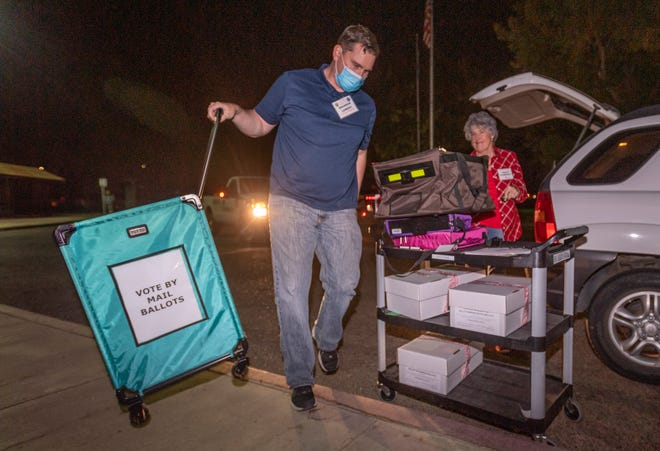 Election workers Brandon Lowery, left, and Judith Ellebracht unload ballots and equipment from the Visalia Library on Tuesday, November 3, 2020 at the Elections Office after the polls closed.
