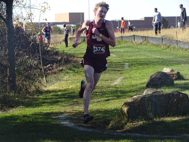 John Glenn's Chris Tooms competes in last week's regional meet where he finished second in Division II. This week, the junior harrier is aiming for an All-Ohio finish in his second state meet.
