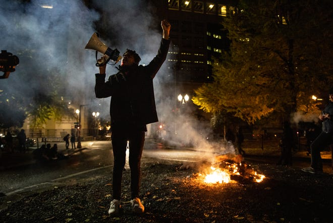 A Black Lives Matter protester chants slogans on Wednesday early morning, Nov. 4, 2020, in Portland, Ore.