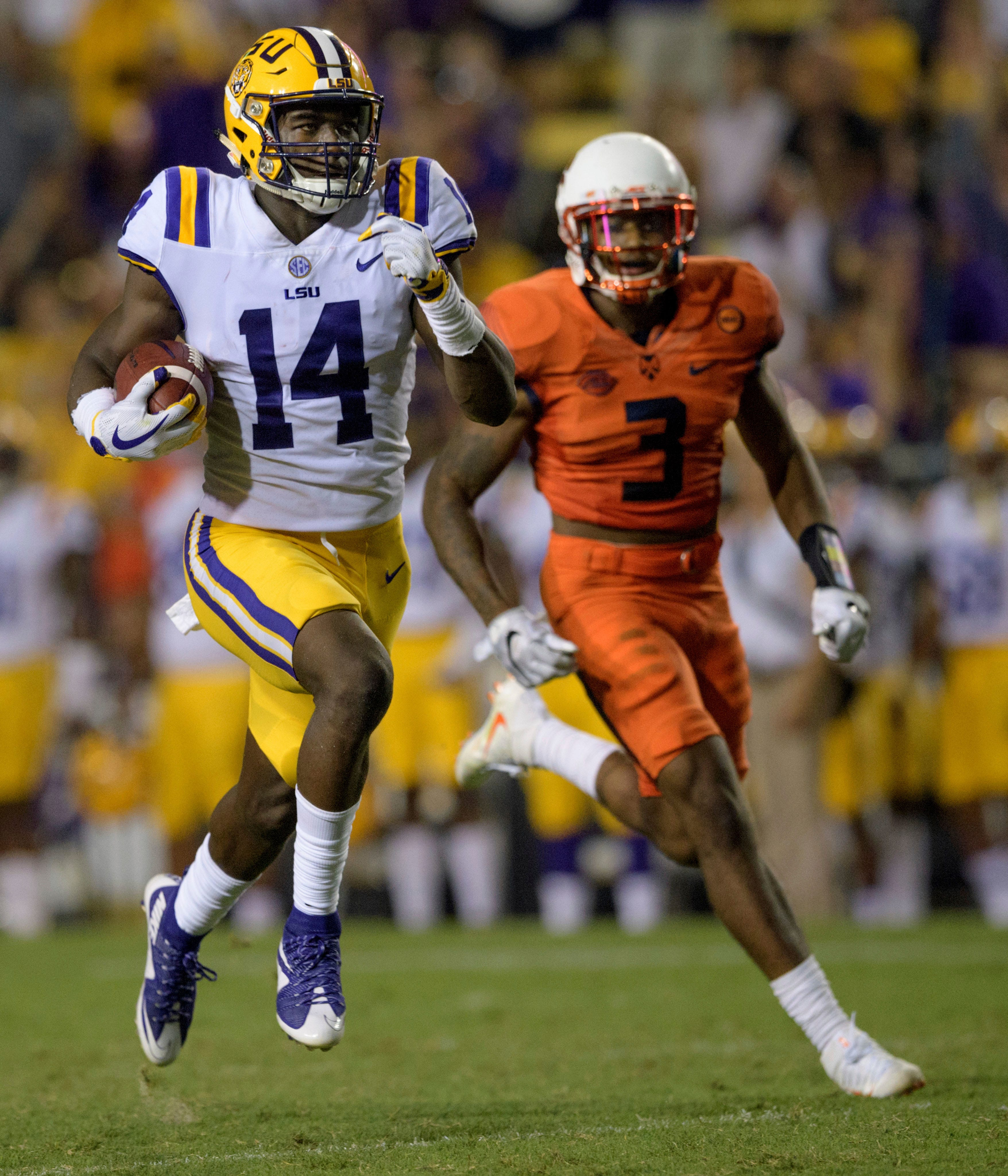 LSU wide receiver Drake Davis (14) runs for a touchdown against Syracuse defensive back Christopher Fredrick (3) during the second half of an NCAA college football game in Baton Rouge, La., Saturday, Sept. 23, 2017.
