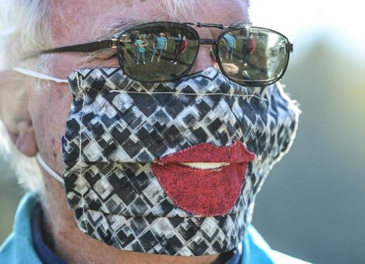 Tommy Forrest, Director of Upstate Quilts of Valor Upstate South Carolina, wears a mask quilted with lips before receiving the 24th annual Jo Brown Senior of the Year award, during the 5th annual Golden Years Jamboree, a drive-through event at the balloon launch field near the Anderson Civic Center Wednesday, Nov. 4, 2020.