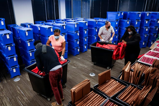 Elections specialists pack up bags in a room filled with counted ballots the day after the election at the Mecklenburg County Board of Elections office on November 4, 2020 in Charlotte, North Carolina.