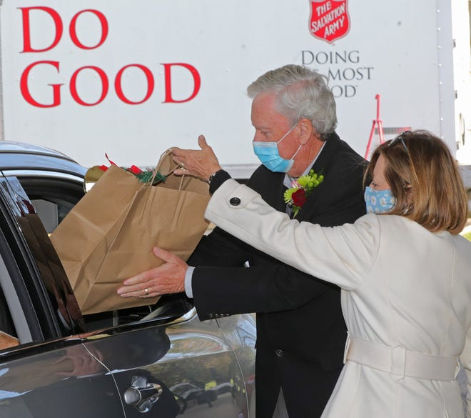Bill and Becky Considine help pass out to-go meals for the Salvation Army's Community Medal Award and Red Kettle Kickoff on Thursday at the St. George Fellowship Hall in Fairlawn.