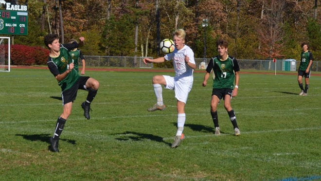 Cherokee's Ian Bialy traps a ball between Benjamin Yaroch (4) and Mark Palladino of Seneca during Thursday's Olympic Conference soccer game.