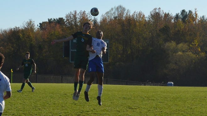 Richie Dole of Clearview (5) and Dayvon Mbu of Williamstown go up for a head ball during the second half of Wednesday's Tri-County Conference game.