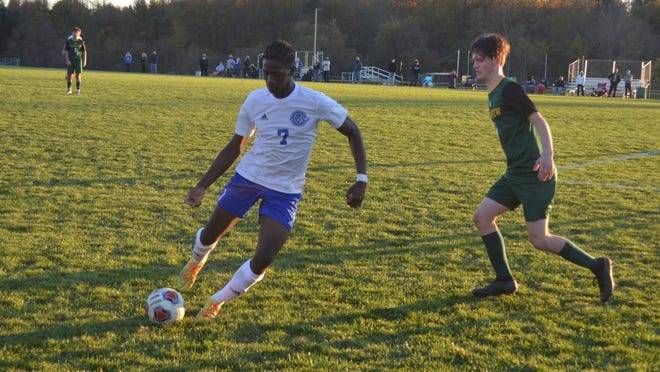 Williamstown's Osa Unuigbe (7) brings the ball upfield as Clearview's Andy Calhoun pursues. Unuigbe scored the first goal in the Braves' 2-0 win.
