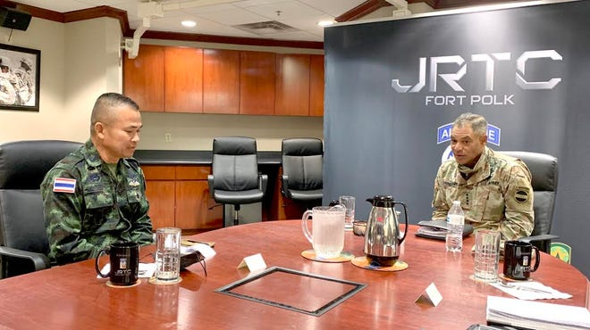 Royal Thai Army Col. Sadet Arkajag, Special Operations Forces mentor (left), visits with Gen. Michael X. Garrett, U.S. Army Forces Command commander, at the Joint Readiness Training Center and Fort Polk Oct. 26 during JRTC Rotation 21-01.