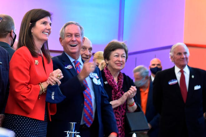 South Carolina Lt. Gov. Pam Evette, left, Rep. Joe Wilson and Gov. Henry McMaster, right, smile as Sen. Lindsey Graham speaks after winning reelection Tuesday in Columbia.