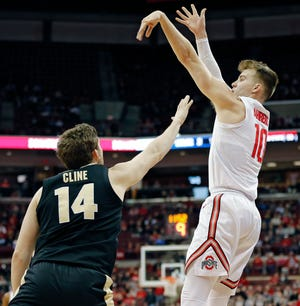 Forward Justin Ahrens, shown shooting against Purdue's Ryan Cline on Jan. 23, 2019, has hit 39.6 from three-point range in two seasons at Ohio State.