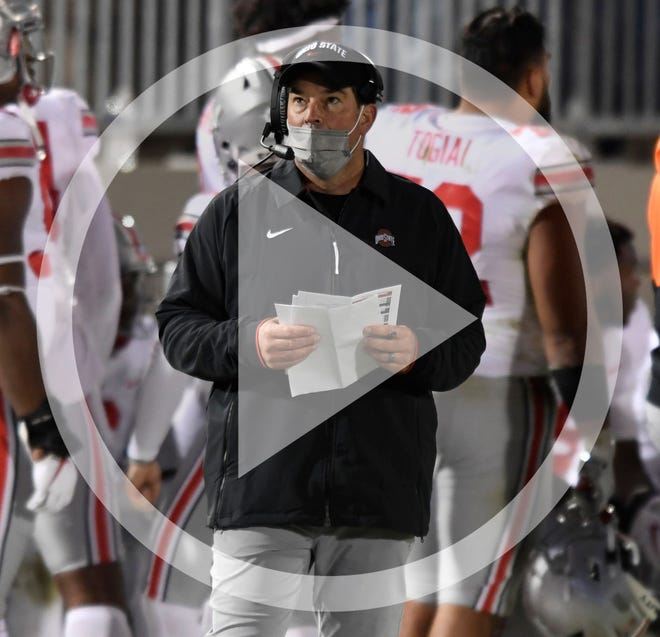 In this file photo, Ohio State coach Ryan Day looks at the scoreboard during the third quarter of the team's NCAA college football game against Penn State in State College, Pa., Saturday, Oct. 31, 2020. Ohio State won 38-25.