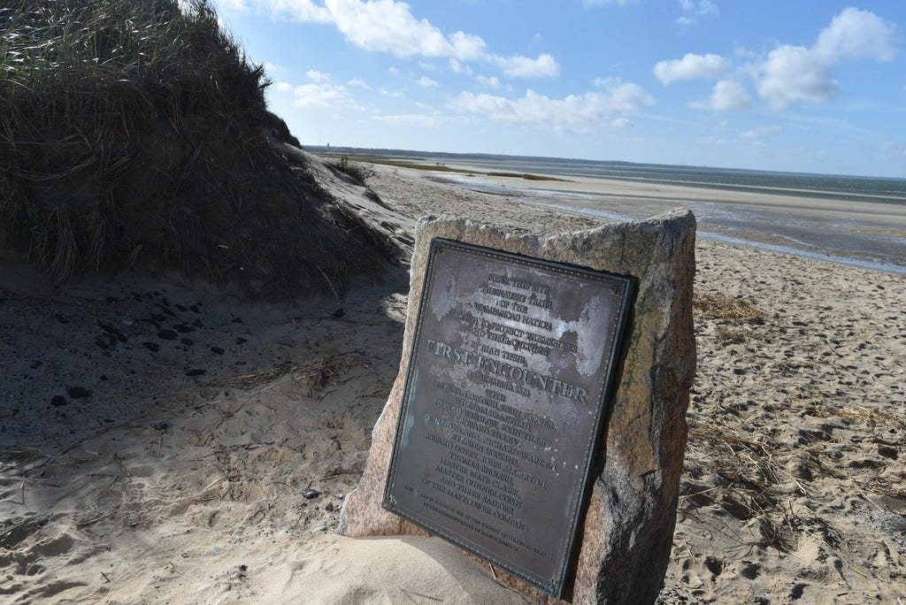 A monument at First Encounter Beach in Eastham describes the Pilgrims' first meeting with the Wampanoag. The beach is the site of a skirmish that led to the Pilgrims leaving to settle in Plymouth.