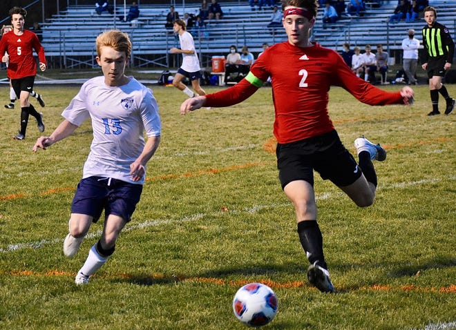Southern Boone's Trenton Roney (2) pursues the ball against Tolton's Tyler Stevens (13) during the Class 1 District 3 championship Wednesday night at Southern Boone High School.