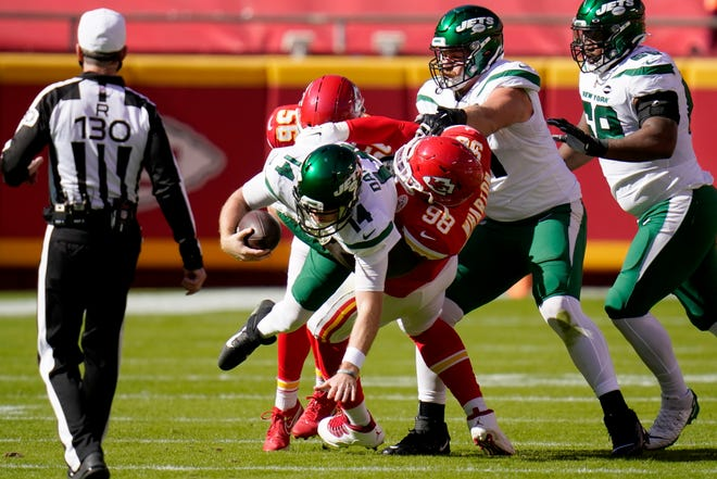 New York Jets quarterback Sam Darnold (14) is sacked by Kansas City Chiefs defensive tackle Tershawn Wharton (98) during a game Sunday at Arrowhead Stadium in Kansas City.