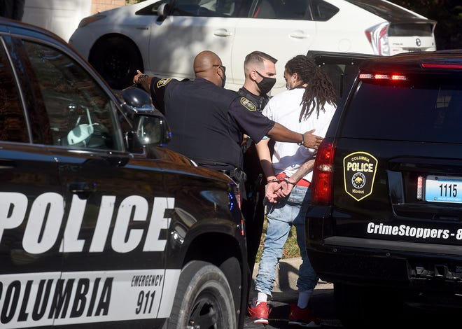 Columbia police take a man into custody on Thursday morning near Kirk Hill Road and Wolf Trail following a foot chase.