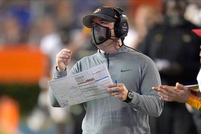 Missouri head football coach Eli Drinkwitz watches during a game against Florida on Saturday night at Ben Hill Griffin Stadium in Gainesville, Fla.