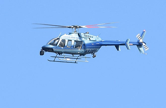 Missouri Highway Patrol helicopter flies along Interstate 70 near The Links apartments in the 5000 block of Clark Lane to help police in the Nov. 5 search.