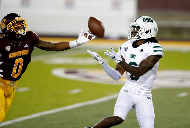 Ohio receiver Isiah Cox, right, catches a pass for a touchdown against Central Michigan's Brian Edwards (0) during an NCAA football game on Wednesday, Nov. 4, 2020, in Mount Pleasant, Mich. Central Michigan won 30-27.