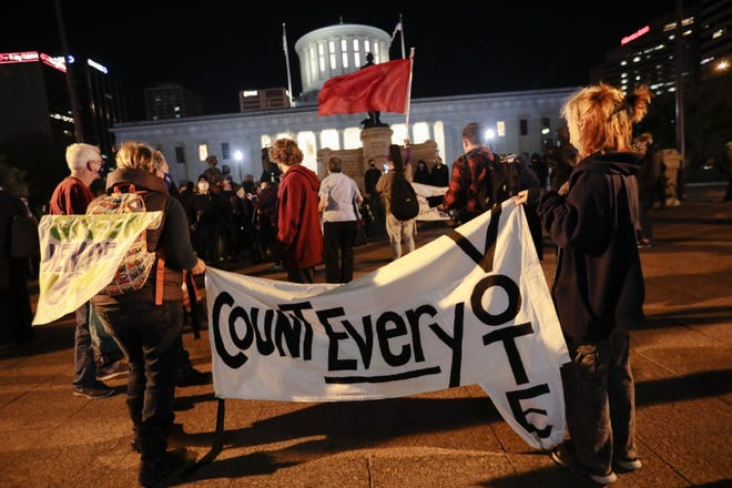 "Demonstrators rally outside the Ohio Statehouse on Wednesday evening during a ""Count Every Vote"" rally. Demonstrators across the country held rallies calling for every vote to be counted in the presidential election between President Donald Trump and Democratic challenger Joe Biden."