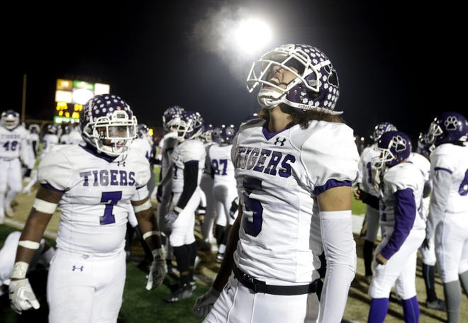 Pickerington Central's Garner Wallace (5) celebrates a win over Mentor in a Division I state semifinal last year. He'll quarterback the Tigers when the teams meet in a state semifinal Friday night.