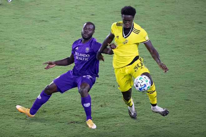 Nov 4, 2020; Orlando, Florida, USA; Orlando City SC forward Benji Michel (19) and Columbus Crew SC defender Aboubacar Keita (30) fight to control the ball  during the second half at Orlando City Stadium. Mandatory Credit: Kim Klement-USA TODAY Sports