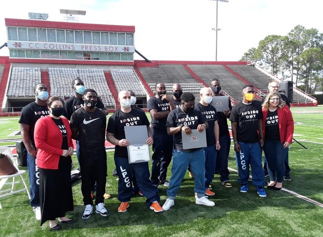 Participants of the Nicholls Inside Out program gather Friday for a group photo during the closing ceremony.