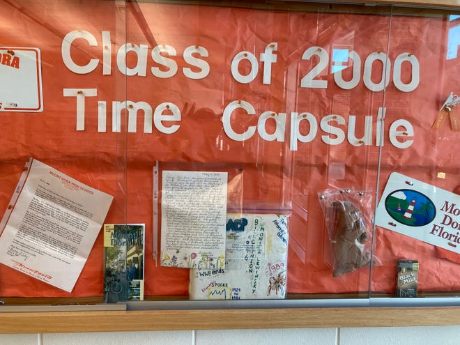 A Mount Dora High School media center display of the items found in the Class of 2000 time capsule. [Submitted]