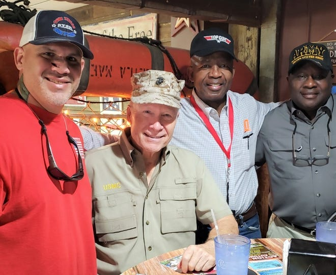 George Wanberg (second from left) and Theo Bob (far right) are two of the speakers for  the traditional November 11 Veterans Day ceremonies slated for Ferran Park in Eustis.  Others pictured are Keith Totten of One Team - One Fight 4 PTSD (left) and Marine Lt. Gen. Ron Bailey, who was Guest of Honor at last weekend's VetFest.