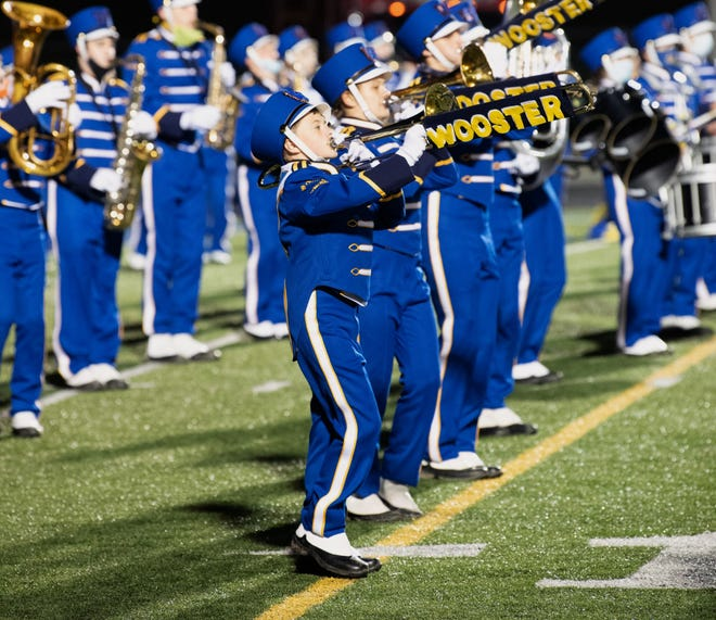 Wooster High School marching band members, donning new uniforms for the first time in 28 years, perform Oct. 30.