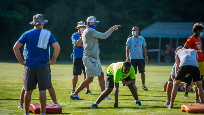 Randleman head coach Shane Timmons calls plays out during a summer workout on Aug. 5.