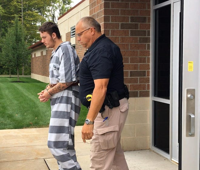 Ferenc Sarkozy, of Toronto, now 23, leaves the office of Summit Township District Judge Brian McGowan after a preliminary hearing Sept. 11, 2018. Sarkozy on Friday pleaded guilty in Erie County Court in the death of 61-year-old Motel 6 employee Gregory Mogush on July 17, 2018. Sarkozy was sentenced to up to 45 years in state prison.