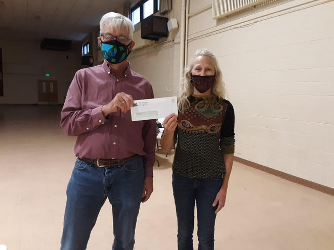 Tri-Parish Ministry presents donation The Tri-Parish Outreach Ministry (St. Paul, Sacred Heart and St. Andrew) presented a donation of $750 for the Thanksgiving meal of the Sisters of St. Joseph Neighborhood Network soup kitchen held at St. Paul Community Center in Little Italy. Pictured are Tom Hudson of the ministry and Lora Caldwell of SSJNN.