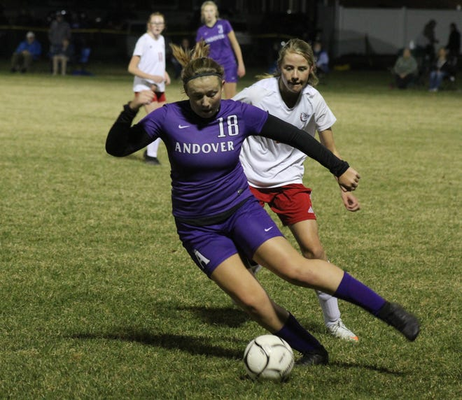 Andover/Whitesville's Kennedy Bledsoe (18) controls the ball Wednesday night against Belfast.