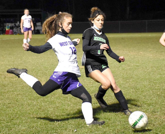 West Canada Valley Indian Faith Stewart (12) winds up to take a shot during the first half of a match played Wednesday in Herkimer, New York.