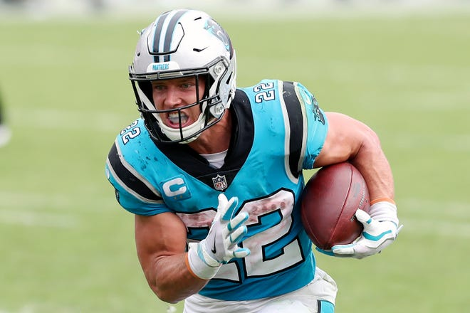 Carolina Panthers running back Christian McCaffrey (22) rushes for a touchdown against the Tampa Bay Buccaneers earlier this season. The Panthers are eager to get Christian McCaffrey back on the field for Sunday's game at Kansas City after he has missed four games with a high ankle sprain.
