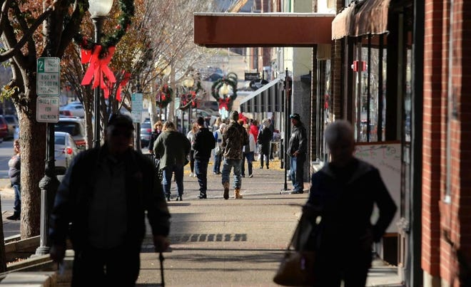 Downtown Burlington businesses will open their doors with specials during the city's Holiday Open House from 10 a.m. to 4 p.m. Sunday.