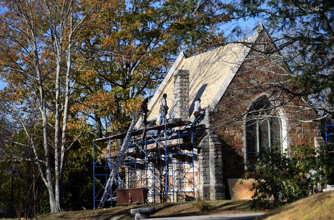 Somersworth cemetery trustees received New Hampshire Land and Community Heritage Investment Program and Moose Plate grants to replace the roof on the Furber Chapel, where a crew works Wednesday, Nov. 4.