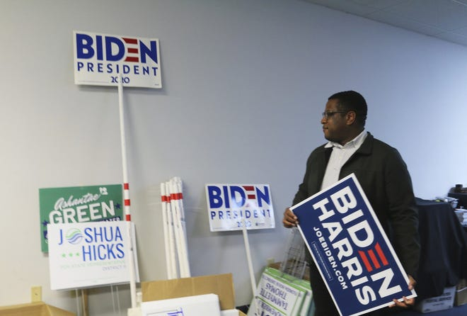 Daniel Henry poses at the campaign headquarters for the Duval County Democratic Party in Jacksonville, Fla., on Thursday, Oct. 22, 2020. Henry is the youngest chair of a major county political party in Florida. (AP Photo/Bobby Caina Calvan)
