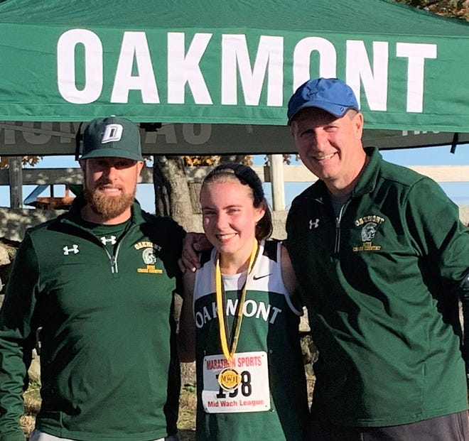 Oakmont's Fiona Picone, center, celebrates her victory in last year's Mid-Wach C League meet with assistant coach Tim Caouette, left, and head coach Ken Jepson.
