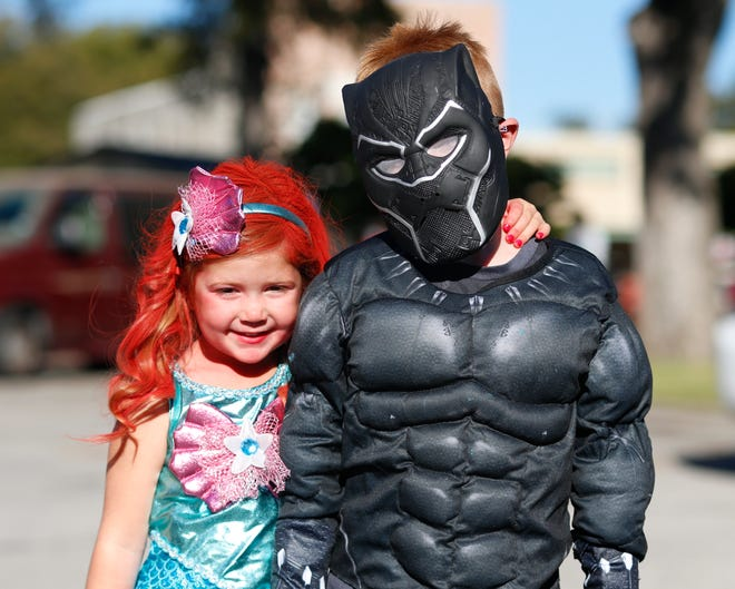 Ariel, (Paisley Aland), and Black Panther, (Stetson Aland), were among the numerous attendees at Saturday's Scare on the Square and Somervell County Sheriff's Office's National Night Out. There was even a dinosaur sighting. In addition, cowboys, super heroes, ball players and all other kinds of scary creatures attended the event on Halloween.