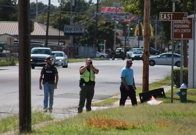 Kinston Police Department investigators assess a two-car shooting on Tuesday, September 3, 2019, that happened around 3 p.m. on Vernon Avenue in front of Grainger Stadium. [Brandon Davis/Kinston Free Press]