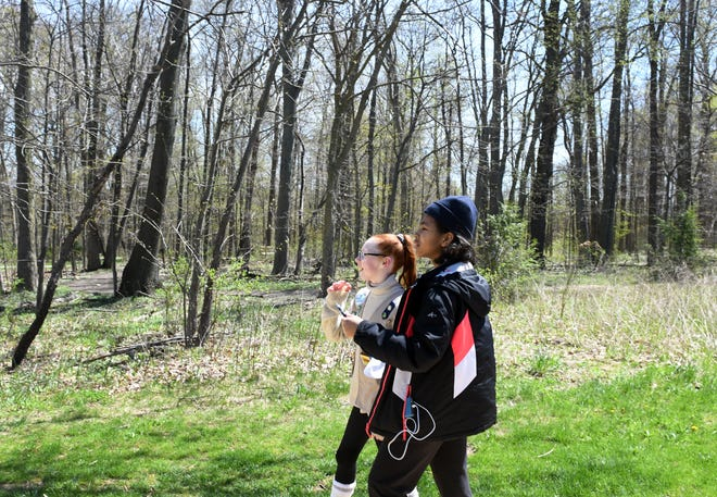 Hannah Kemmerling, 12, and Chloe Gibson, 12, at an Earth Day scavenger hunt at Liberty Park in April 2019. The city of Twinsburg, which owns about a third of the area, has been annexed into the Summit Metro Parks taxing district, a move that was put on hold for almost 10 years after the city bought the land and put the parks district in charge of managing the property.