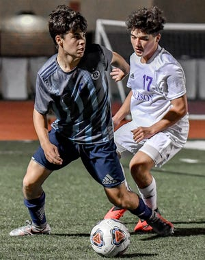 Hudson defender Zach Bleifer looks to pass the ball ahead of Jackson's Joe Bostic during the Explorers' 2-1 home loss Nov. 4 in Division I regional semifinal game.