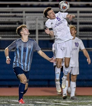 Hudson's Quinn Groves watches a header from Jackson's Troy Atkinson during the Explorers' 2-1 home loss to Jackson Nov. 4 in a Division I regional semifinal game.
