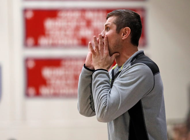 Idalou coach Tyler Helms yells out to his players during the Region I-3A regional final game Feb. 29 at the Hutcherson Center in Plainview.