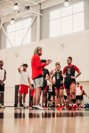 Texas Tech first-year coach Krista Gerlich gives instructions to her team before a preseason practice.