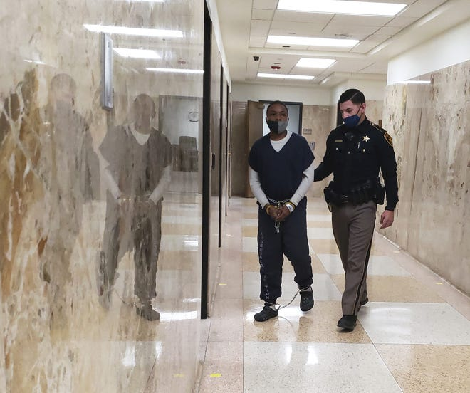 A Lubbock County sheriff's deputy escorts Detren Ward out of the 364th District Court were he was sentenced to 10 years in prison in connection with his girlfriend's June 2019 shooting death.
