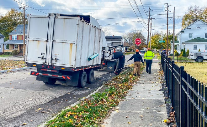 City Department of Public Works crews pick up loose leaves on Onondaga Street. Crews will continue to pick up loose leaves until the middle of November.