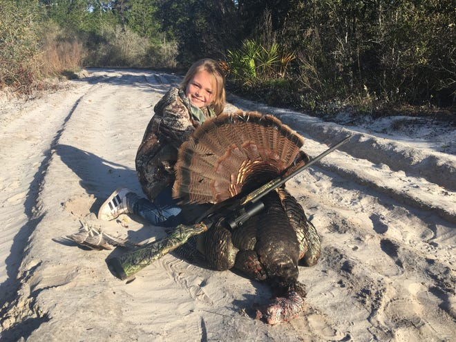 The author's daughter, Cile Nance, with her first public-land Osceola gobbler, harvested in March. The process for applying for those public-land spring hunts begins this month.